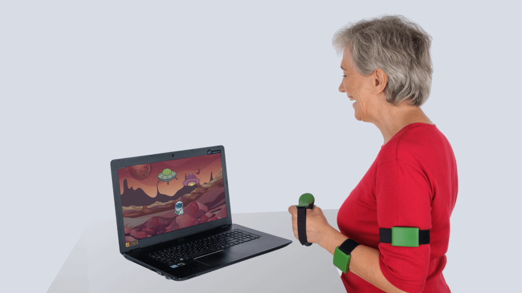 Raccoon.Recovery physical therapy exercises software and a patient playing rehabilitation games with Raccoon.Recovery devices