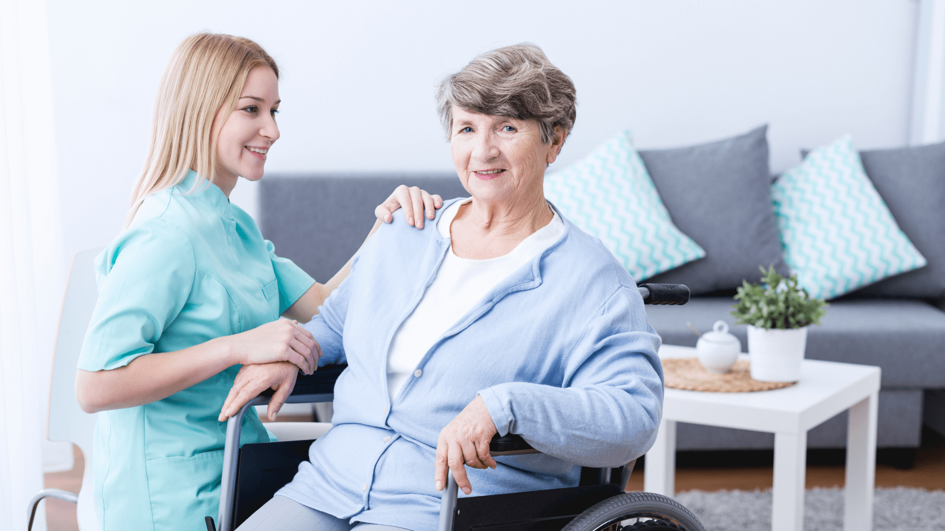 Physiotherapy specialist communicates with an elderly patient with disabilities
